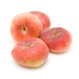 De perziken van de doughnut die op wit worden geïsoleerdt Stock Foto