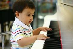 De piano van het spel Stock Foto