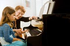 De pianoleraar royalty-vrije stock afbeelding