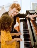 De pianoleraar Stock Foto's