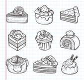 De pictogrammen van de krabbelcake Stock Foto's