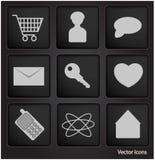 De pictogrammen van het Web in zwarte vierkante knoop Stock Foto's