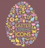 De pictogrammen van Pasen en van de lente in een eivorm Stock Foto