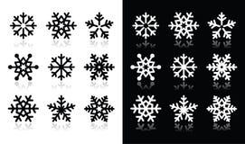 De pictogrammen van sneeuwvlokken met schaduw op zwart-wit Royalty-vrije Stock Afbeelding