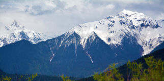 De piek van de sneeuwberg Stock Afbeelding
