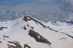 De Pieken van de berg Stock Foto