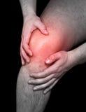 De pijn van de knie Stock Foto's