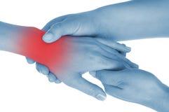 De pijnlijke pols, hand, getoond rood, houdt overhandigd Royalty-vrije Stock Afbeeldingen