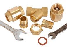 De pijp, de klep en de moersleutel van het loodgieterswerk Royalty-vrije Stock Foto