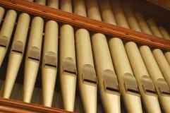 De Pijpen van het Orgaan van de kerk stock afbeeldingen