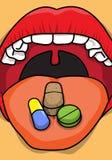 De Pillen en de Tabletten van Mediical op Tong Royalty-vrije Stock Foto's