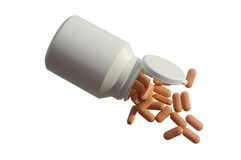 De pillen van de geneeskunde met een witte fles stock afbeeldingen