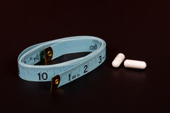 De pillen van het dieet met meetlint Stock Afbeelding