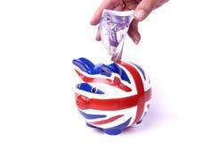 De pippy bank van Union Jack met geld Stock Fotografie
