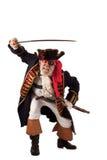 De piraat valt vooruit met opgeheven zwaard uit Stock Foto