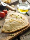 De pizza van Calzone Stock Afbeeldingen