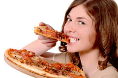 De pizza van meisjesbeten Stock Foto's