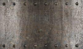 De plaat of het pantsertextuur van het metaal met klinknagels Stock Afbeeldingen