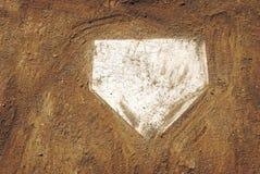 De plaat van het huis op honkbalveld Stock Foto's