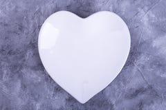 De plaat in de vorm van hartvlakte lag Royalty-vrije Stock Afbeelding