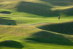De plaats en de zonsondergang van het golf stock fotografie