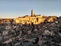 De plaats van de de werelderfenis van Unesco van Matera - zonsondergang in Basilicata, Zuid-Italië stock afbeelding