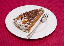 De plak van de cake met een vork Stock Afbeelding