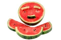De plak van watermeloen met dat maakt een het glimlachen gezicht royalty-vrije stock afbeeldingen