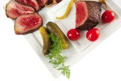 De plakken en de groenten van het rundvlees Royalty-vrije Stock Afbeeldingen