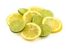 De plakken van de citroen en van de kalk Stock Afbeelding