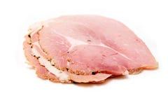 De plakken van de ham die op wit worden geïsoleerd Stock Foto's