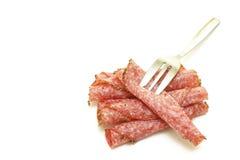 De plakken van de salami Stock Afbeeldingen
