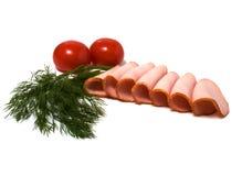 De plakken van de tomaat en van het vlees die op wit worden geïsoleerdr Stock Foto