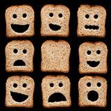 De plakken van het brood met gezichtsuitdrukkingen royalty-vrije stock afbeeldingen
