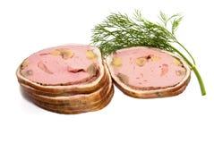 De plakken van het vlees die op wit worden geïsoleerd Stock Foto