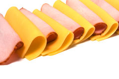 De plakken van het vlees en van de kaas die op wit worden geïsoleerdi Royalty-vrije Stock Foto
