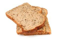 De plakken van volkorenmeel zaaiden bruin brood stock foto