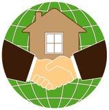 De planeet en het huis van het silhouet met handdruk Royalty-vrije Stock Foto's