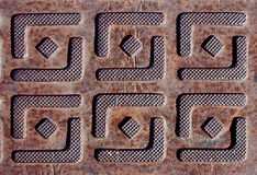 De plaque métallique avec gravé en relief des conceptions carrées Image stock