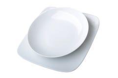 De platen van het diner (die op wit worden geïsoleerdr) Royalty-vrije Stock Afbeeldingen