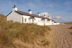 De Plattelandshuisjes van het strand Stock Afbeeldingen