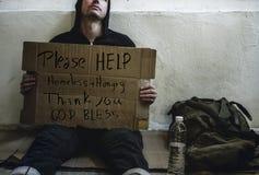 De pleidooien helpen Dakloze Mensen met honger royalty-vrije stock fotografie