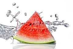 De plons van de watermeloen en van het water Stock Foto
