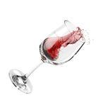 De plons van de wijn in glas Stock Afbeelding