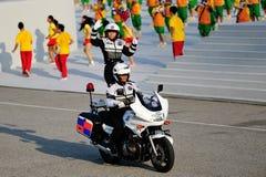 De politie die van het verkeer stunts uitvoert tijdens NDP 2012 Stock Foto