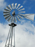 De pomp van het de windmolenwater van het landbouwbedrijf Stock Foto's