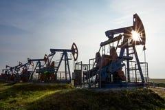 De pompen van de olie Stock Foto's