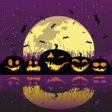 De pompoenen van Halloween onder de maan Royalty-vrije Stock Foto