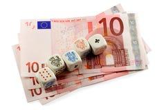De pook dobbelt in euro geld Stock Afbeeldingen