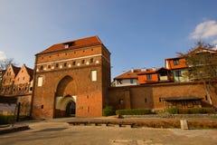 De Poort van het klooster, Torun, Polen Stock Foto's